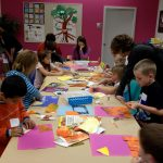 Families making art at a Family Art Workshop