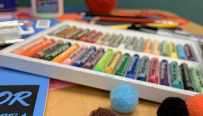 an assortment of craft supplies on a table