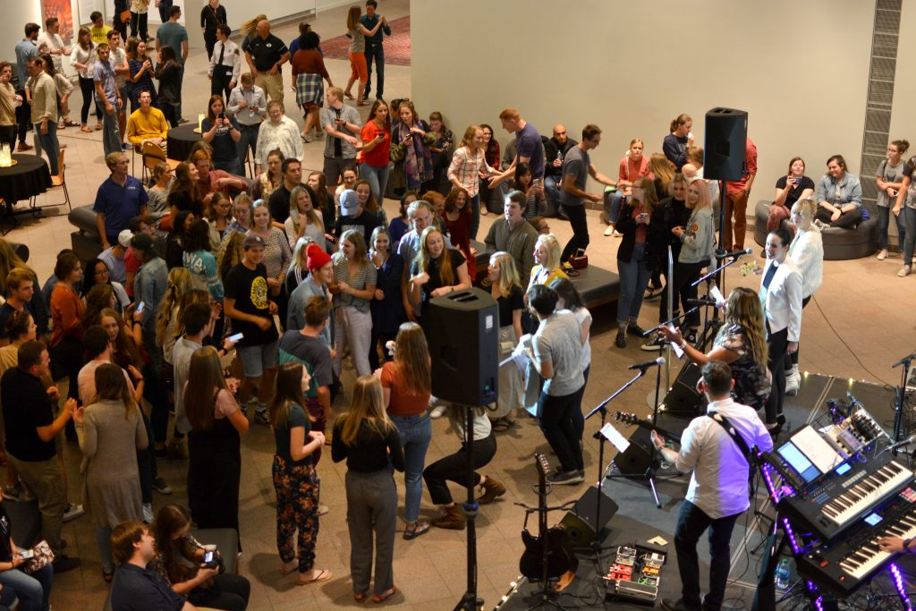 students dancing to a band at the museum