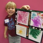 Child showing off Art work from Van Gogh to Play Dough